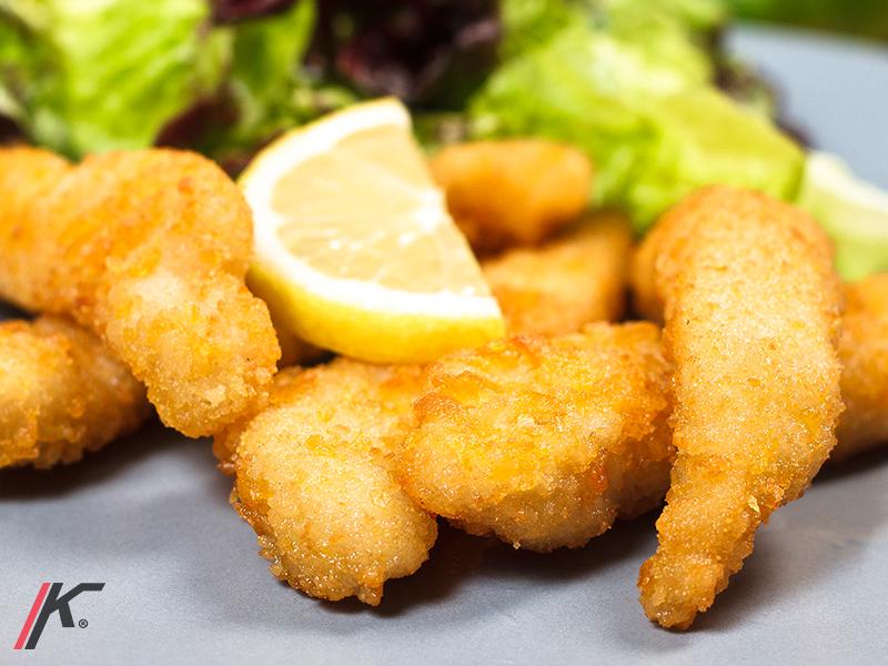 Fried chicken sirloin strips lemon and salad