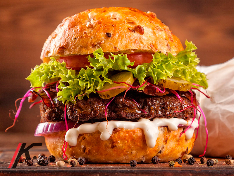 Angus grill burger in a bund, onion, sauce